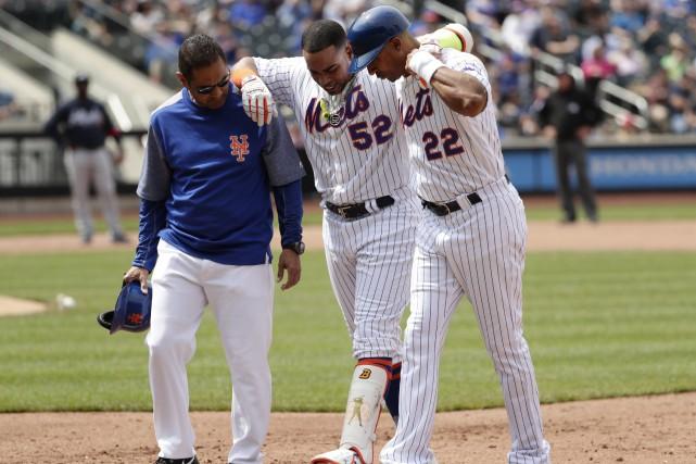 Yoenis Cespedes (au centre) souffre d'une blessure aux... (Photo Frank Franklin II, AP)
