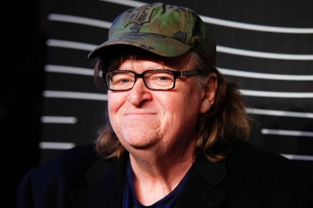 Engagé politiquement, résolument marqué à gauche, Michael Moore... (Archives AP)