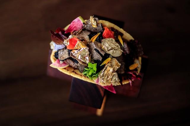 Le tacos est composé de langoustes, de boeuf... (Photo AFP)