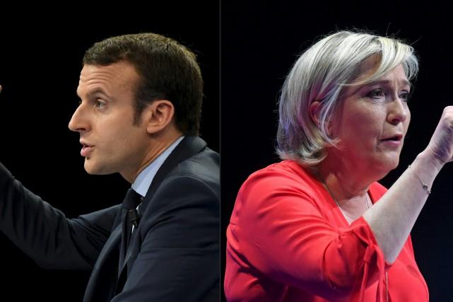 Emmanuel Macron, du mouvement En Marche!, et Marine... (AFP)