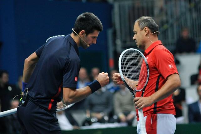 Novak Djokovictravaillait avec son entraîneur Marian Vajda depuis... (Photo Samuel Kubani, archives AFP)