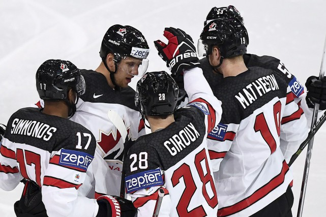 La troupe canadienne célèbre après un but dans... (Franck Fife, AFP)