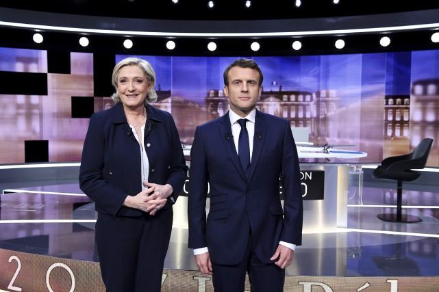 Le duel entre Marine Le Pen et Emmanuel... (Associated Press)
