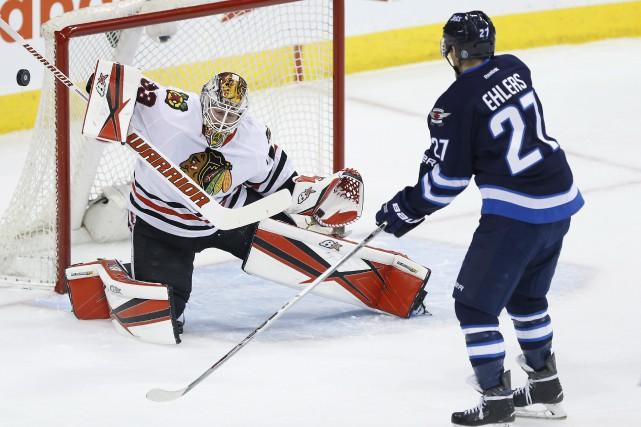 En 32 matchs avec les Blackhawks cette saison,... (Photo John Woods, La Presse canadienne)