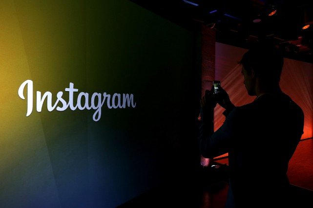 Le réseau social Instagram de partage de photos... (PHOTO ARCHIVES AFP/GETTY IMAGES)