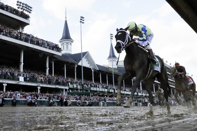 John Velazquez et son cheval Always Dreaming ont... (Photo David J. Phillip, AP)