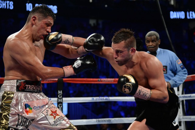 David Lemieux (à droite) frappe au visage Marco... (Photo Joe Camporeale, USA TODAY Sports)