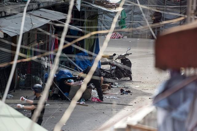 Les deux explosions qui ont secoué le bureau... (PHOTO NOEL CELIS, AGENCE FRANCE PRESSE)