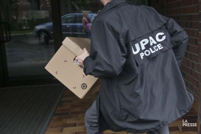 Des documents perquisitionnés par l'UPAC dans les bureaux... (Archives La Presse)