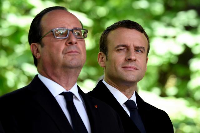 Emmanuel Macron (à droite) a assisté mercredi au... (AP, Eric Feferberg)