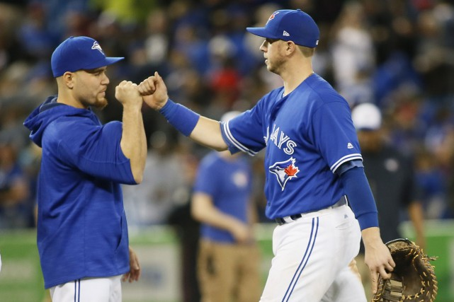 Russell Martin et Justin Smoak... (Photo  John E. Sokolowski, USA TODAY Sports)