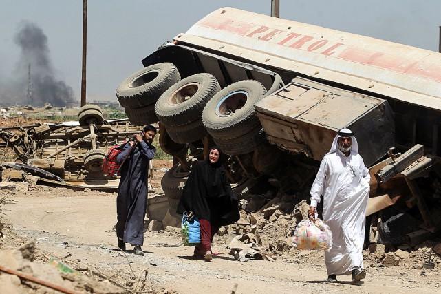 Au total, près de 500000personnes ont fui Mossoul... (PHOTO AHMAD AL-RUBAYE, AGENCE FRANCE-PRESSE)