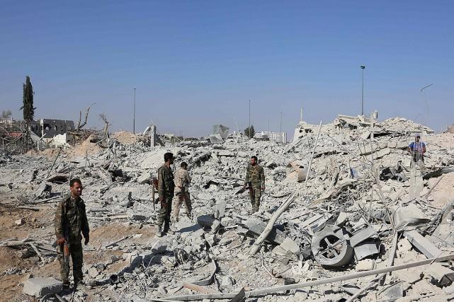 «L'évacuation des hommes armés de Qaboun est en... (AFP)