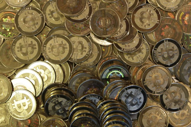 Le bitcoin, qui tire son origine d'un logiciel... (THE ASSOCIATED PRESS)