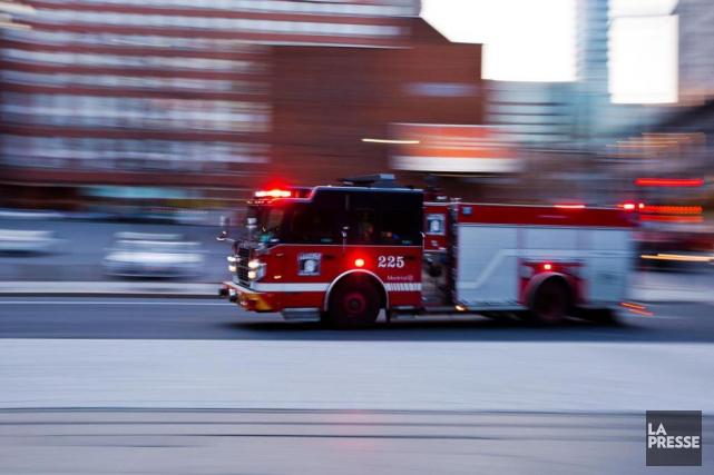 Ce sont les pompiers du Service incendie de... (Photo Olivier Jean, Archives La Presse)
