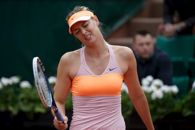 Maria Sharapova a promis mercredi de «se relever»... (Archives AFP, Kenzo Tribouillard)