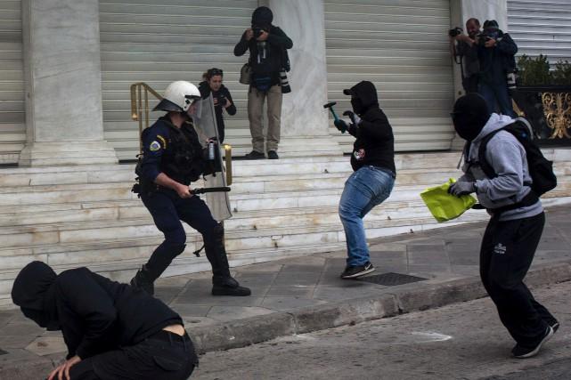 Un rassemblement anti-austérité a dérapé dans la violence... (AFP, Angelos Tzortzinis)