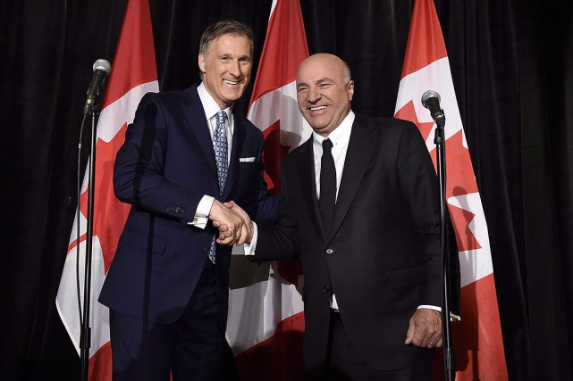 Maxime Bernier et Kevin O'Leary, photographiés ensemble fin... (Nathan Denette, archives PC)