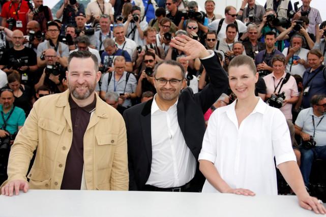 Le réalisateurAndreï Zviaguintsev (au centre) entouré de ses... (PHOTO REUTERS)