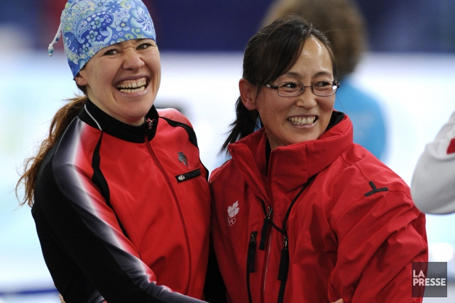 Clara Hughes et Xiuli Wang.... (Photo Bernard Brault, archives La Presse)