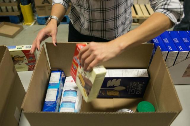 Les Québécois visitent moins les banques alimentaires que... (PHOTO MARTIN TREMBLAY, ARCHIVES LA PRESSE)