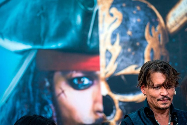 L'acteur Johnny Depp reprend son rôle de Jack... (Photo Johannes Eisele, Agence France-Presse)