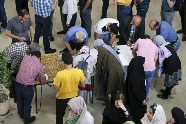 Selon plusieurs médias, 30 millions d'électeurs iraniens -... (AP, Vahid Salemi)