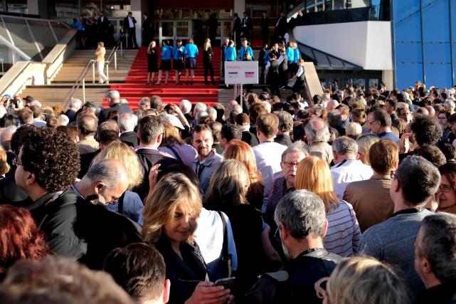 Festivaliers et représentants des médias ont dû évacuer... (AFP, Alberto PIZZOLI)