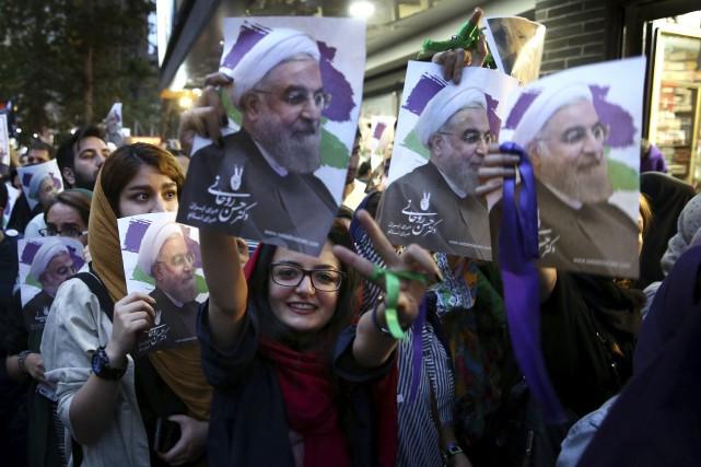 Avec 23,5millions de bulletins à son nom,Hassan Rohani... (Photo Ebrahim Noroozi, AP)