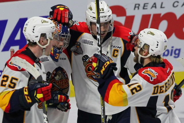 TJ Fergus, Troy Timpano, Dylan Strome et Alex... (Photo Dave Chidley, La Presse Canadienne)