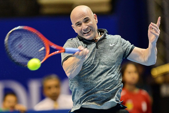Andre Agassi, qui a pris sa retraite en... (PHOTO ROSLAN RAHMAN, ARCHIVES AGENCE FRANCE-PRESSE)
