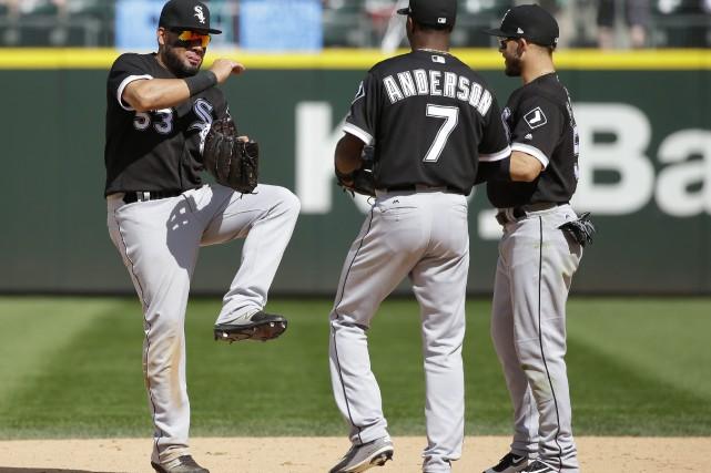 Melky Cabrera, Tim Anderson et Yolmer Sanchez célèbrent... (Photo Ted S. Warren, AP)