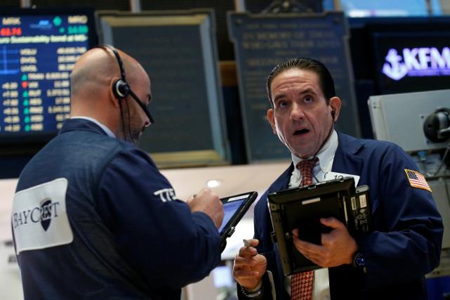 Les Bourses nord-américaines ont légèrement monté mardi, à l'aide notamment de... (Photo REUTERS)