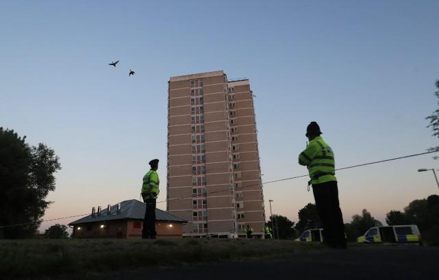 Mercredi soir, une femme a été arrêtée dans... (PHOTO AP)