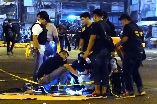 Les circonstances et les éventuels commanditaires de l'attentat... (PHOTO AFP)