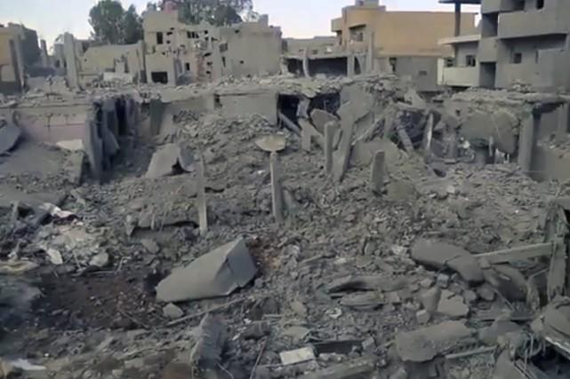 Des maisons détruites àBoukamal.... (Photo archives AP/AAMAQ)