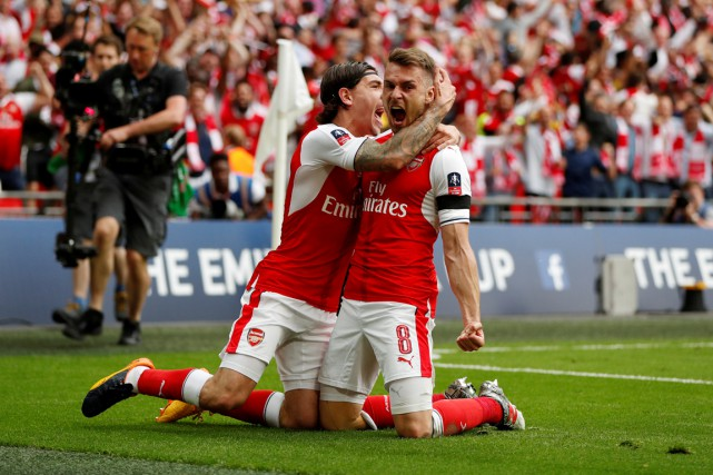 Aaron Ramsey (8) célèbre le but gagnant en... (Photo John Sibley, Reuters)