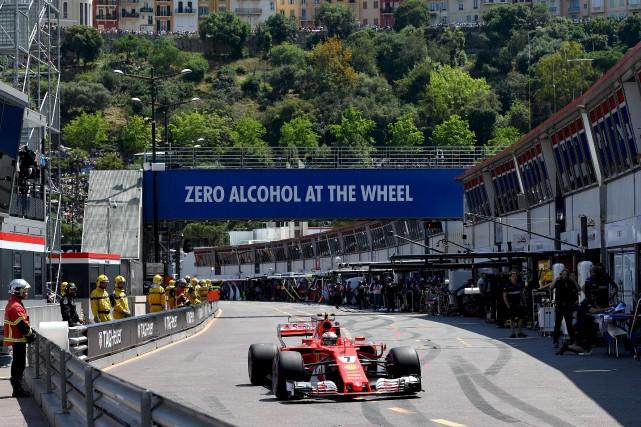 Kimi Raikkonen a récolté la pole position du... (AFP, Andrej Isakovic)