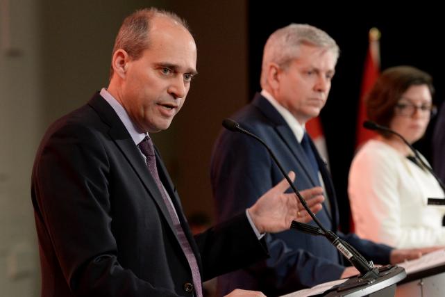 Guy Caron, Charlie Angus, et Niki Ashton, trois... (Archives La Presse canadienne, Justin Tang)