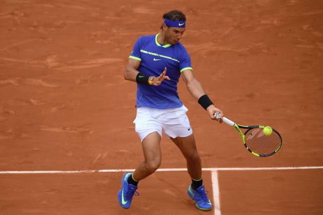 Rafael Nadala balayé le Français Benoît Paire 6-1,... (Photo Lionel Bonaventure, AFP)