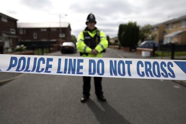 Une semaine après l'attentat suicide à Manchester, la police britannique a... (Photo JOHN SUPER, Agence France-Presse)