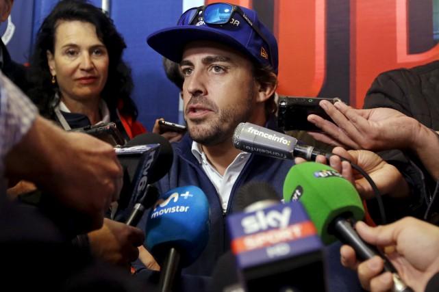 L'Espagnol Fernando Alonso a offert à Renault ses... (AP, Michael Conroy)