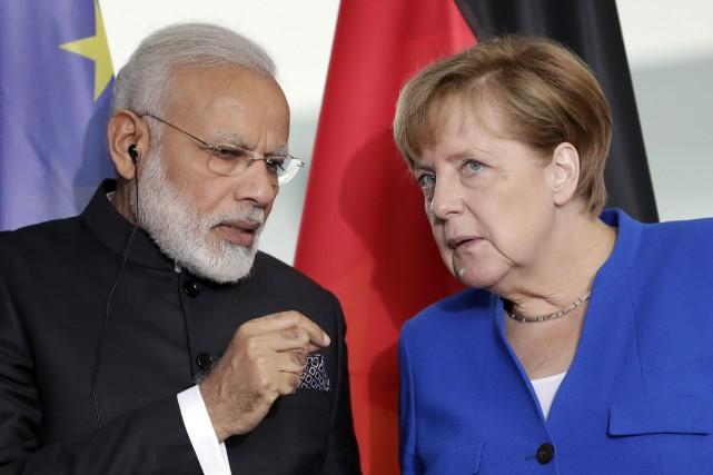 La chancelière allemande Angela Merkel et le premier... (AP)