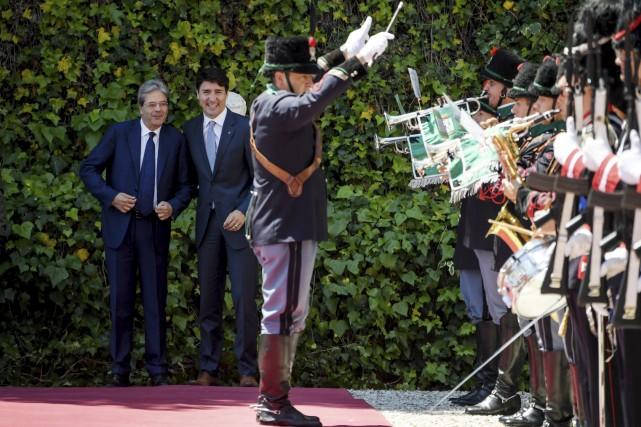Le premier ministre italien Paolo Gentiloni et Justin... (AFP, Andreas Solaro)