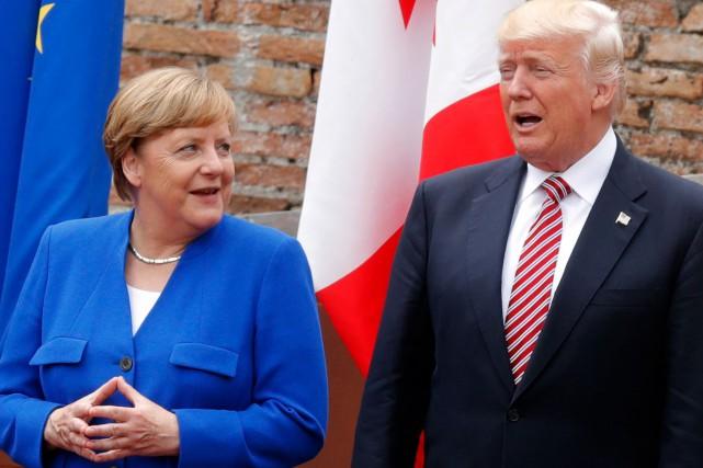 Angela Merkel et Donald Trump au G7, vendredi... (AFP)