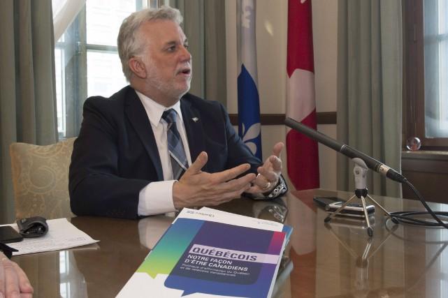 Le premier ministre Philippe Couillard a présenté sa... (La Presse canadienne, Jacques Boissinot)