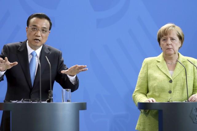 Le premier ministre chinois, Li Keqiang, et la... (AP, Michael Sohn)