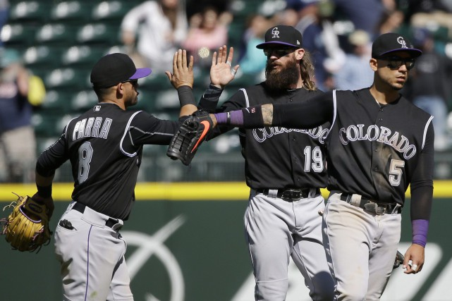 Gerardo Parra, Charlie Blackmon et Carlos Gonzalez... (PHOTO Ted S. Warren, AP)
