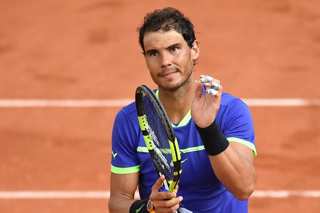 Rafael Nadaln'a passé que 1h30 sur le court,... (Lionel Bonaventure, Agence France-Presse)