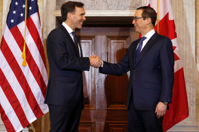 Steven Mnuchin (à droite) et William F. Morneau... (Photo Joshua Roberts, archives Reuters)